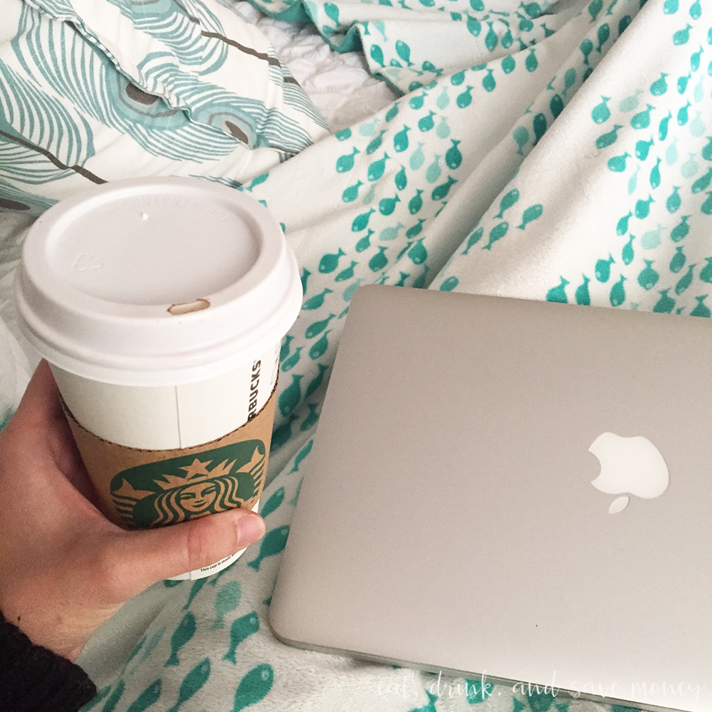 In bed working and drinking coffee
