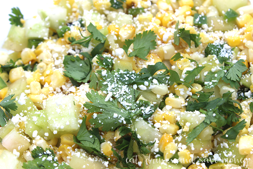 Close up shot of the most delicous street corn salad- green tomato and corn salad