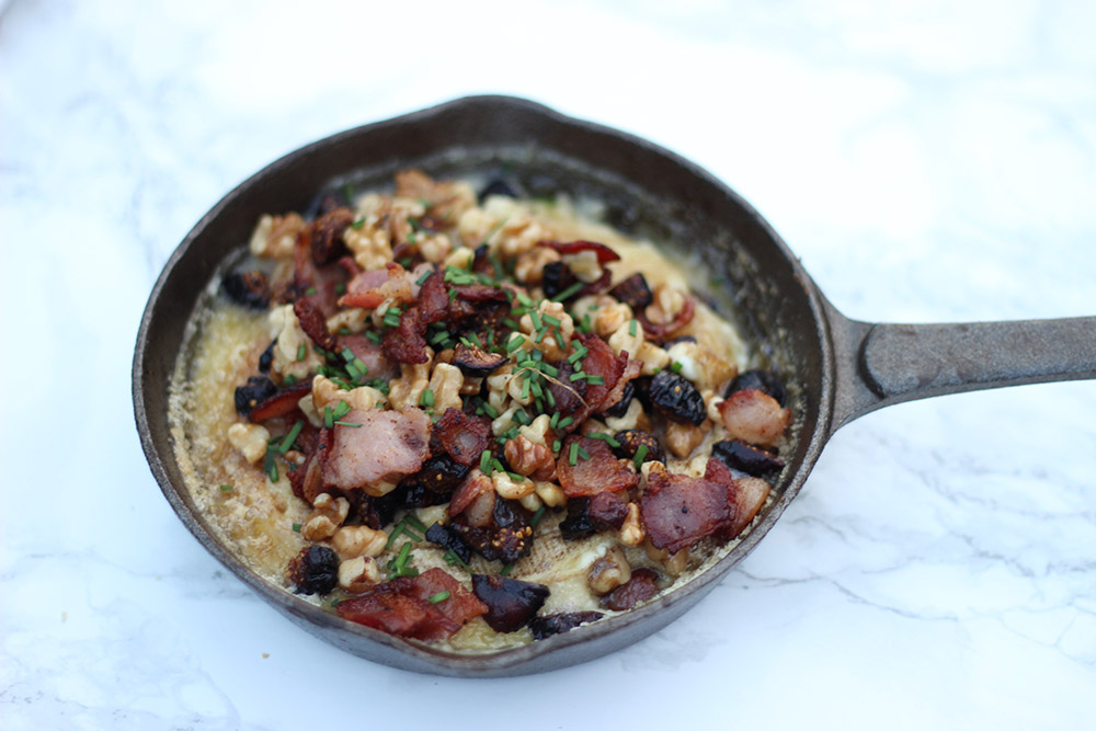 baked brie with bacon, figs, chives, and walnuts