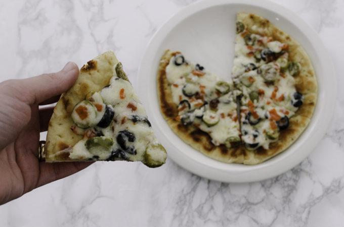 Cheesy olive flatbread pizza