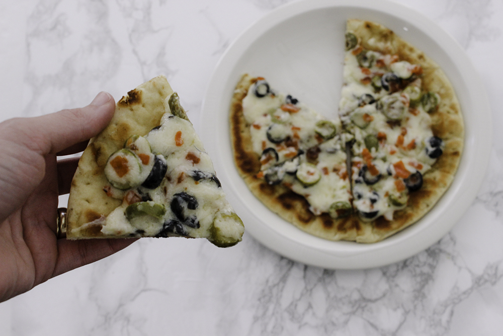 Cheesy olive flatbread pizza