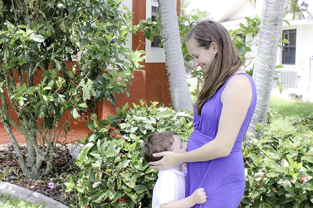 Robert kissing mommy's belly Easter 2017