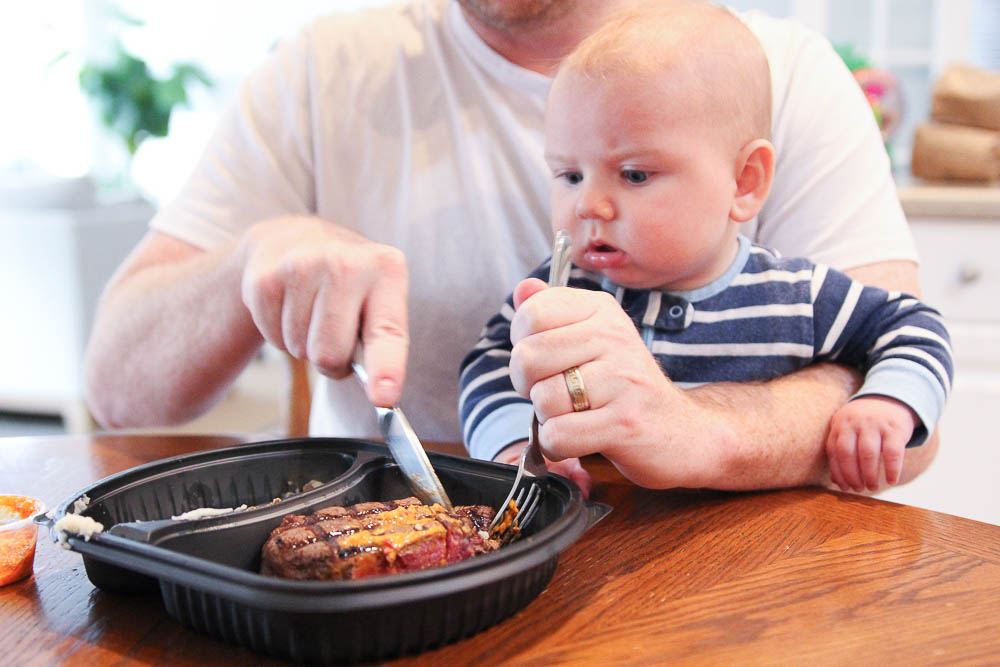 Baby Max looking at the Carrabba's delivery steak