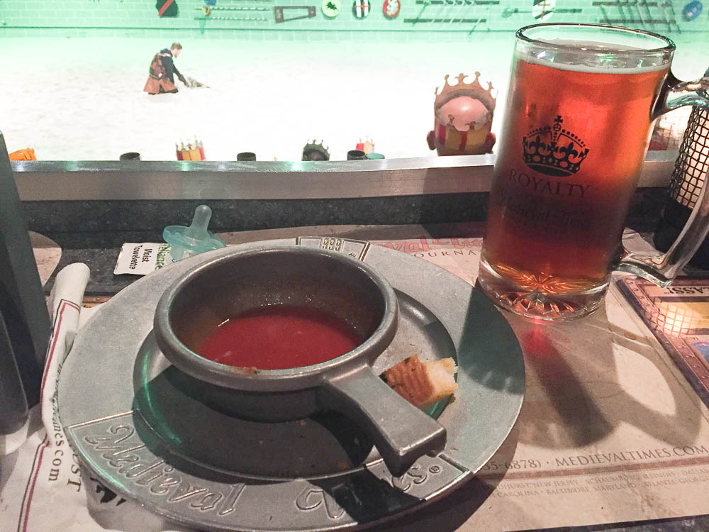 Medieval times dinner is eaten without utensils. The tomato soup is delicious.