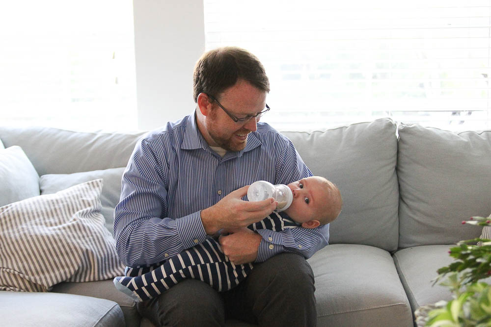 Dad feeding baby with a Phillips Avent Bottle