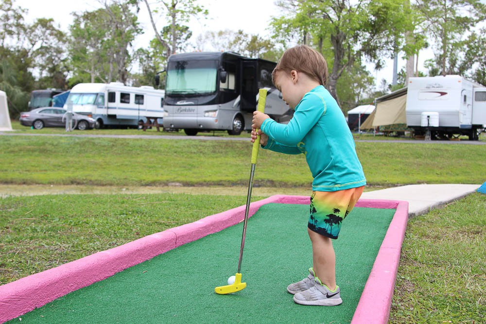 affordable tiny houses in Orlando playing mini golf at thousand trails