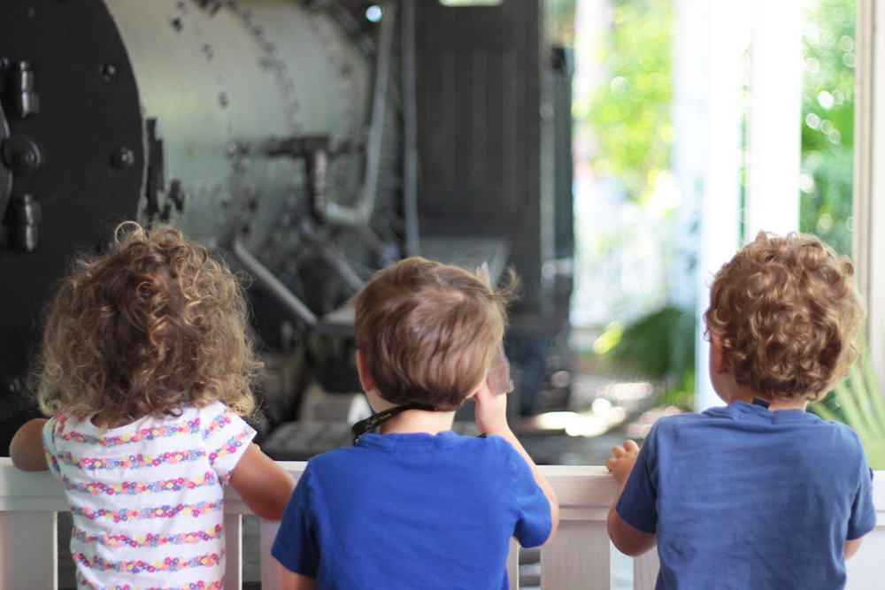 Kids watching the train at the Collier museum