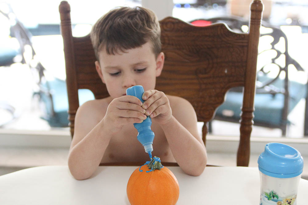 Robert and Jackson painting pumpkins halloween 2017