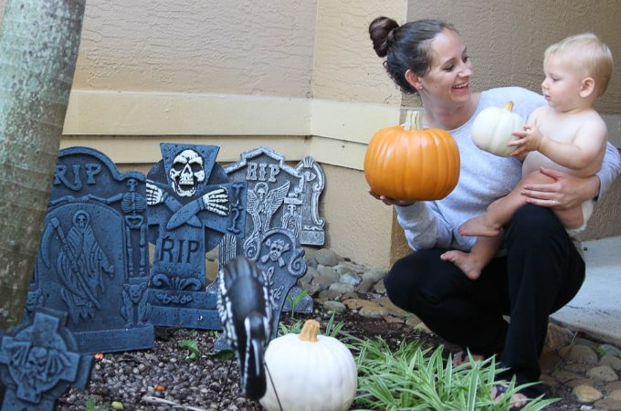 Hannah and Max decorating the front porch for Halloween with pumpkins-5