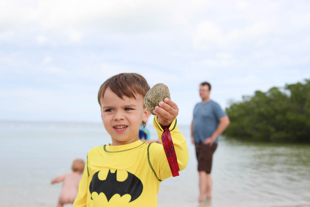 Jackson with a shell in Islamorada. What to do in Islamorada with kids