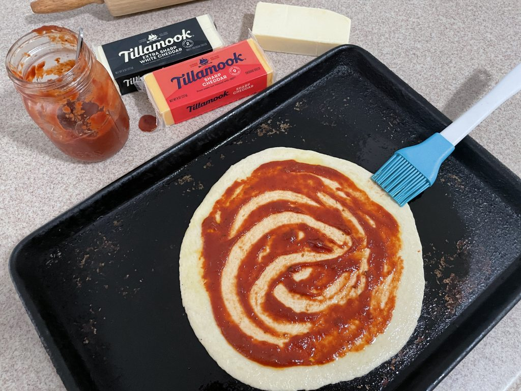 Sauce the pizza
