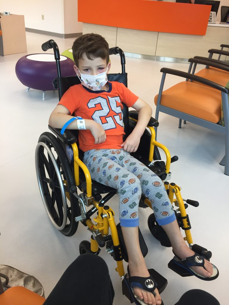 Robert in wheelchair with HSP